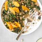 toasted quinoa kale salad with oranges, hazelnuts and lemon tahini dressing