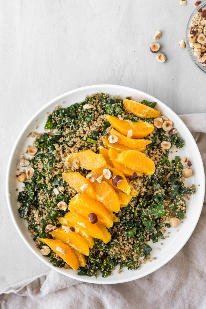 kale grain salad with quinoa and oranges and tahini dressing