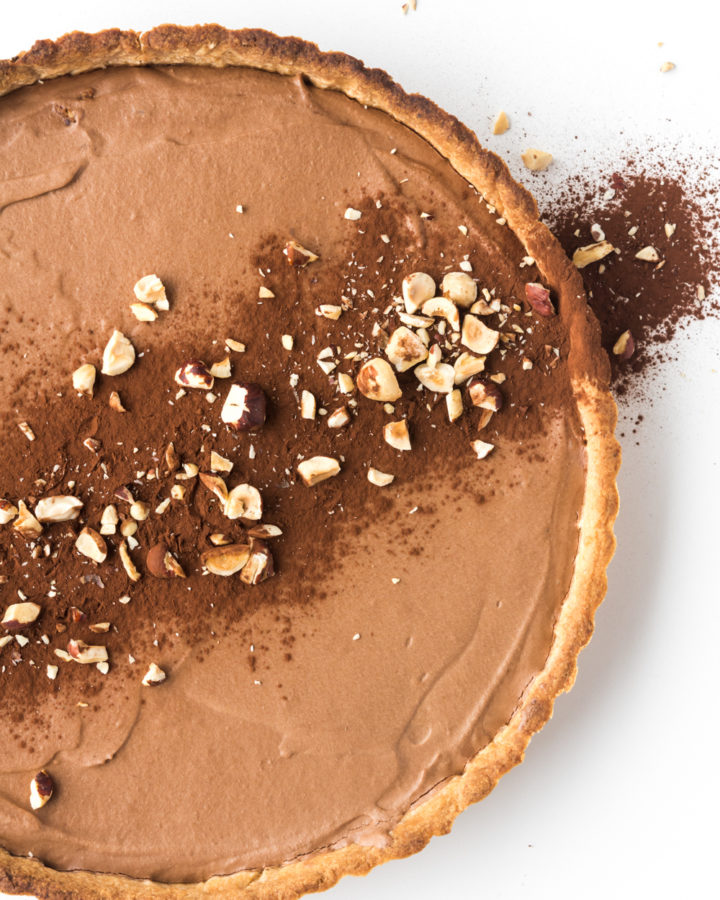 chocolate mousse tart with roasted hazelnut crust
