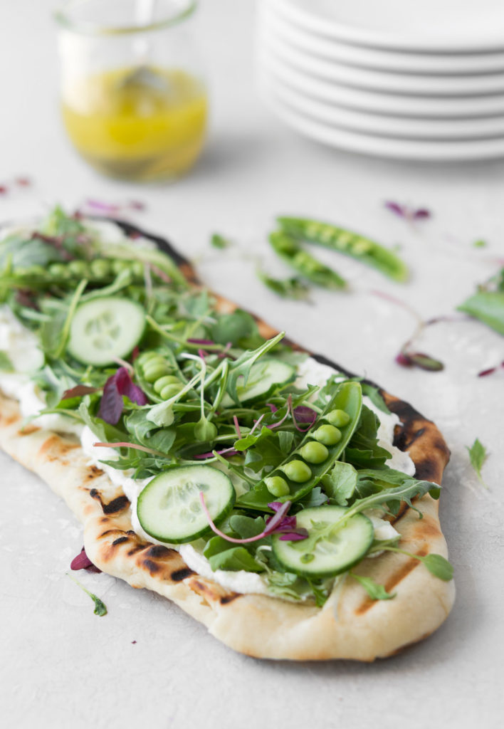 grilled flatbread with ricotta, arugula and peas