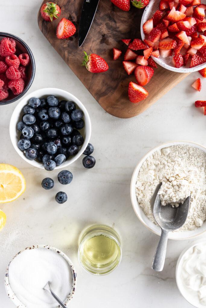 strawberries, blueberries, raspberries, creme fraiche, lemons