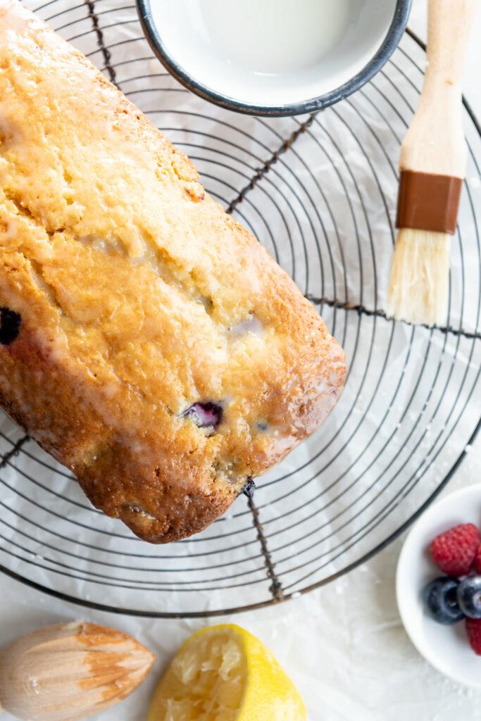 triple berry cake with lemon glaze