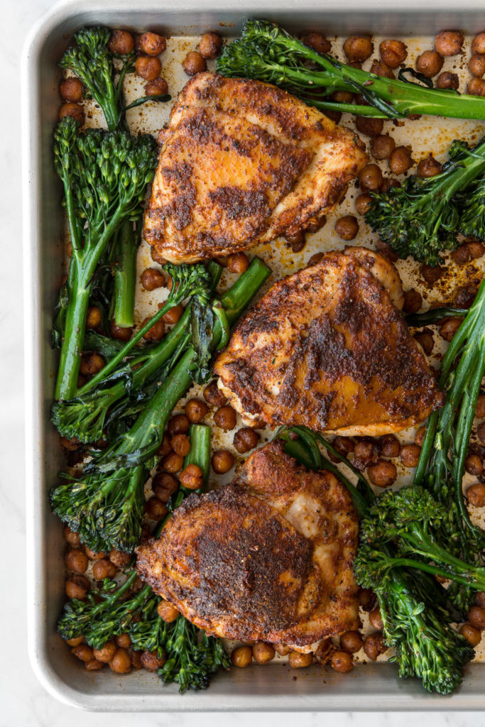 sheet pan chicken thighs with harissa, broccolini and chickpeas