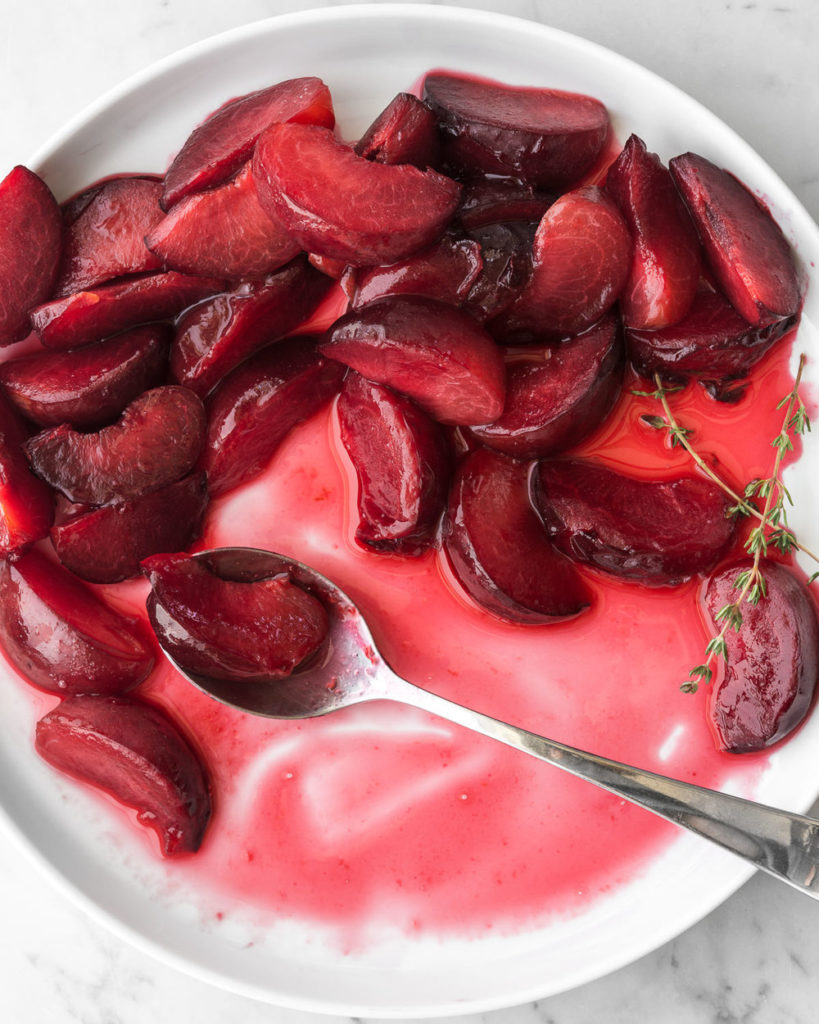 poached summer plums in honey thyme syrup
