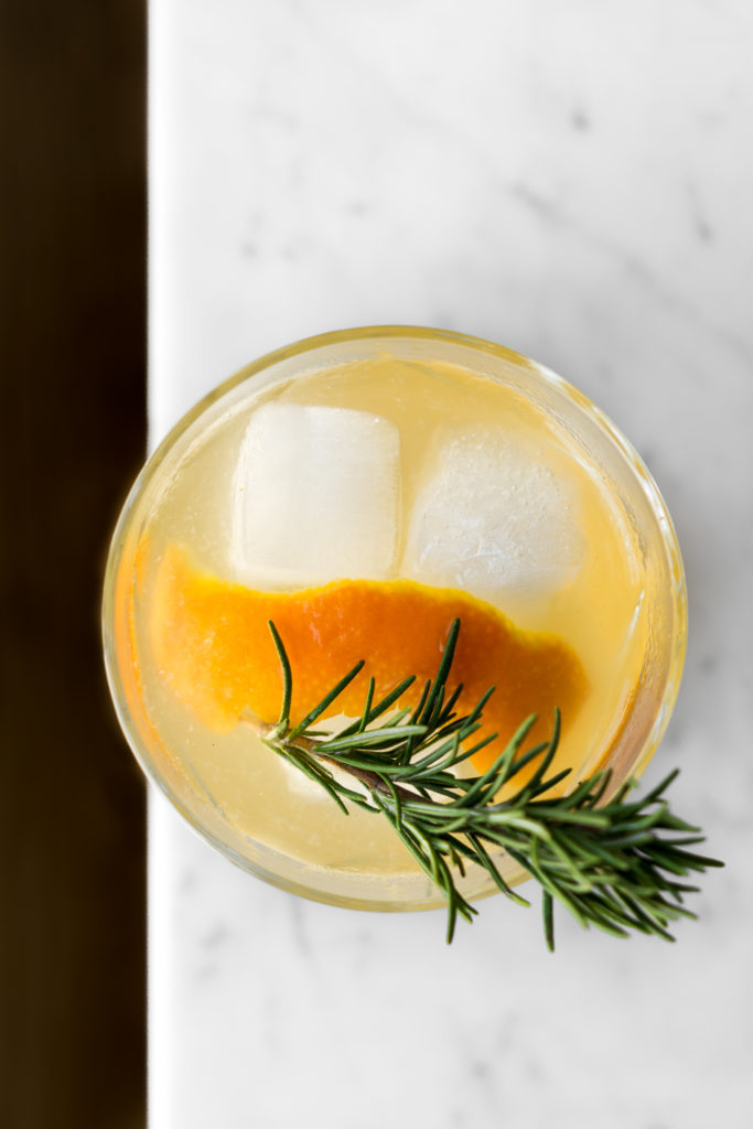 how to make a shrub cocktail with gin, citrus and rosemary oleosaccharum