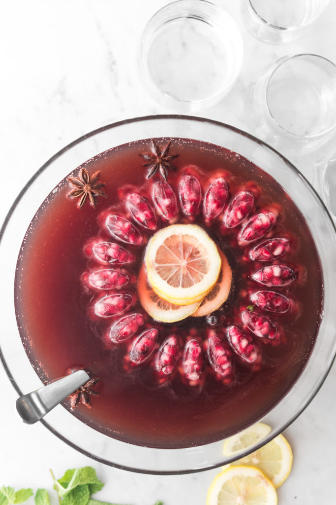 holiday whiskey punch with cherries and champagne