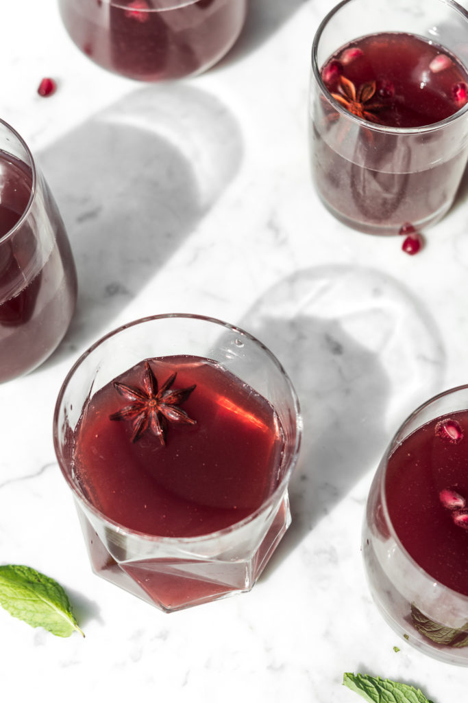 rye whiskey punch with sour cherries, spiced simple syrup, lemon juice and champagne