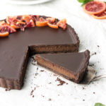 double chocolate tart with candied orange slices