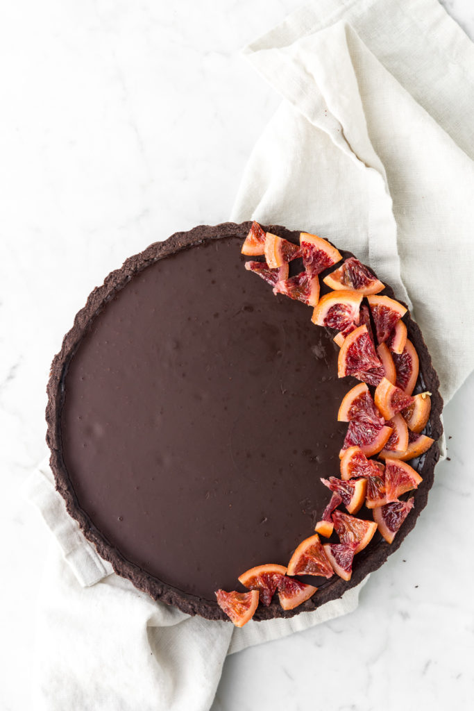 rich bitterwseet chocolate tart with candied blood oranges