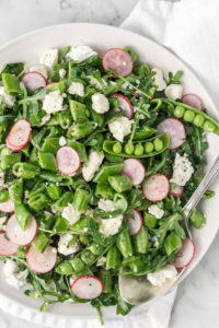 sugar snap pea salad with radishes, feta and arugula