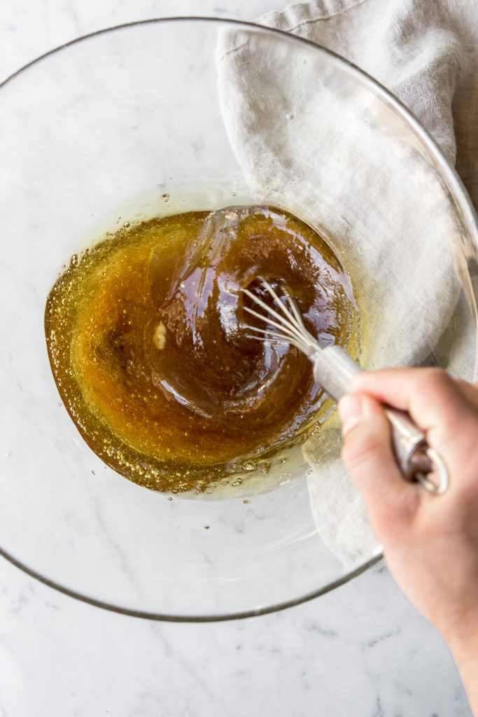 whisking olive oil and maple syrup