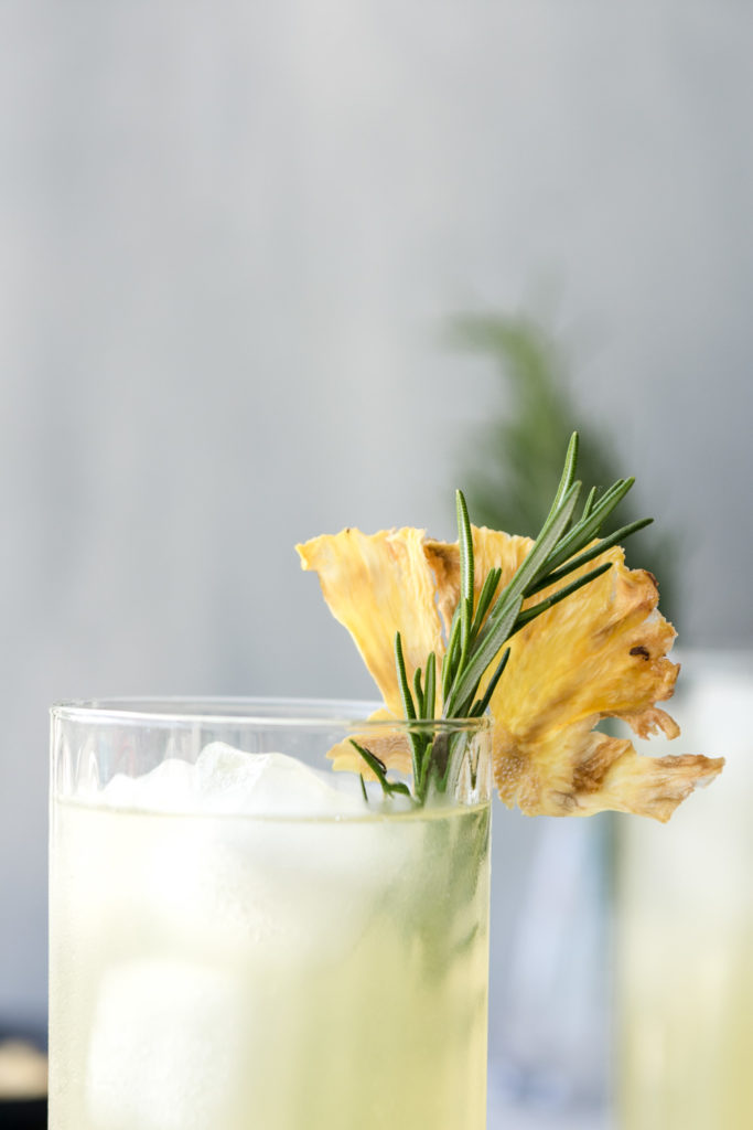 pineapple rum cocktail with dried pineapple flowers
