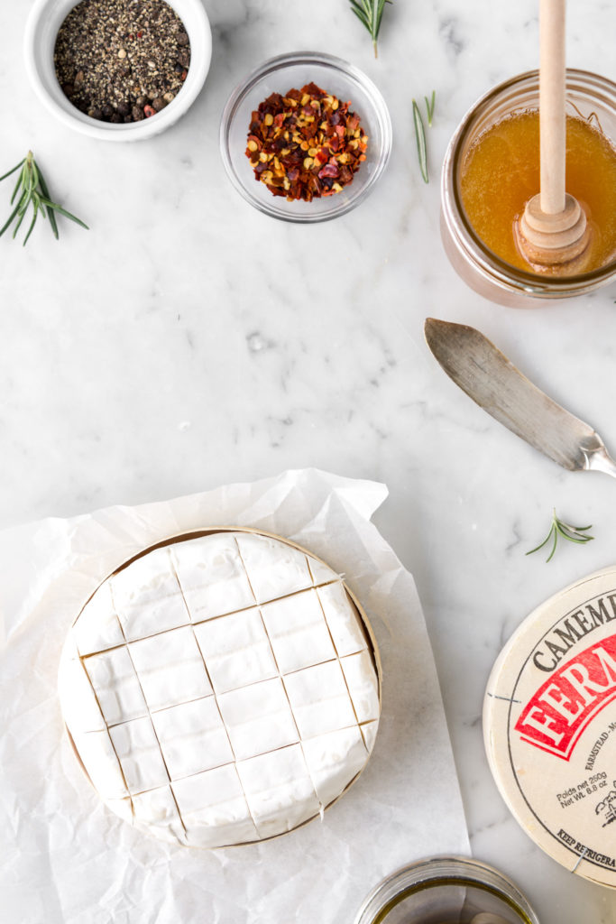crosshatch scored camembert with honey, red pepper flakes and black pepper