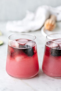 blackberry tequila spritzer with red wine float on top