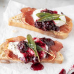 burrata crostini with crispy prosciutto, blackberry honey sauce and fried sage