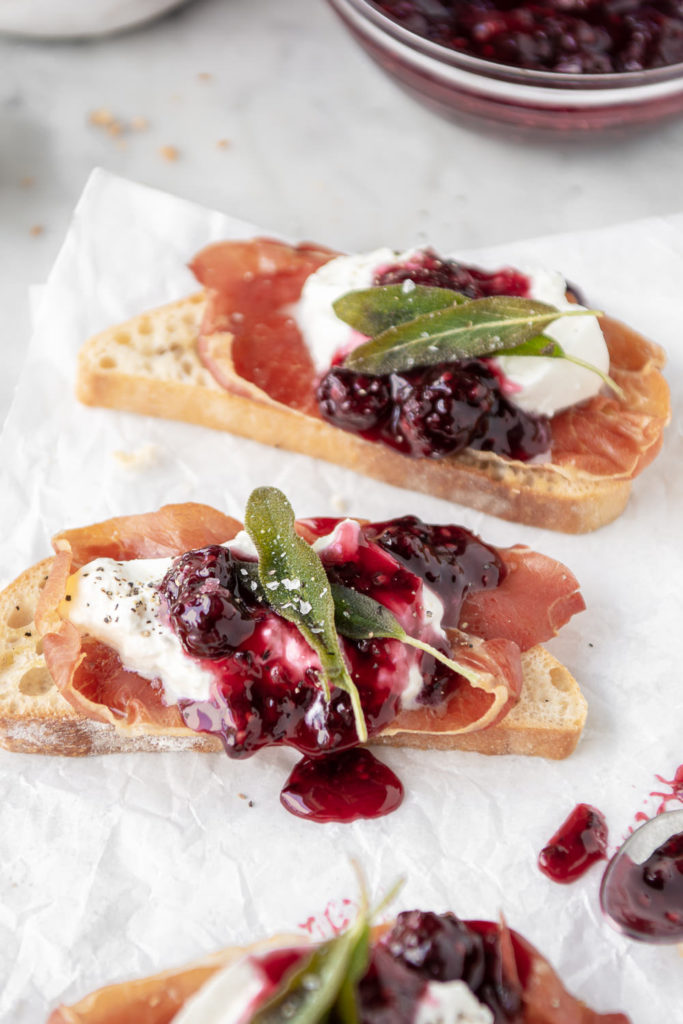 burrata toast with crispy prosciutto, blackberry honey sauce and fried sage