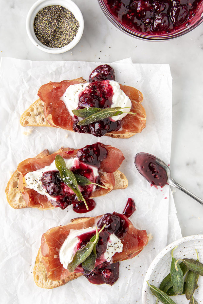 burrata crostini with prosciutto, blackberries and fried sage