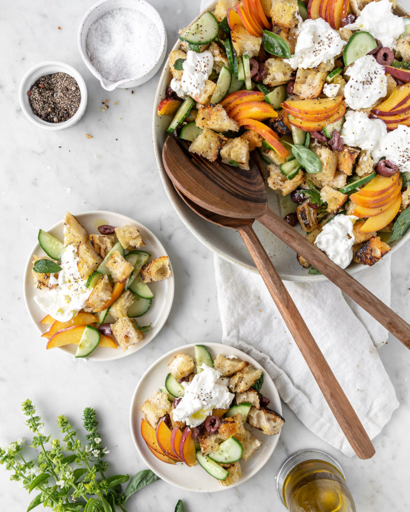 grilled panzanella salad with peaches, cucumber, olives, burrata and herbs