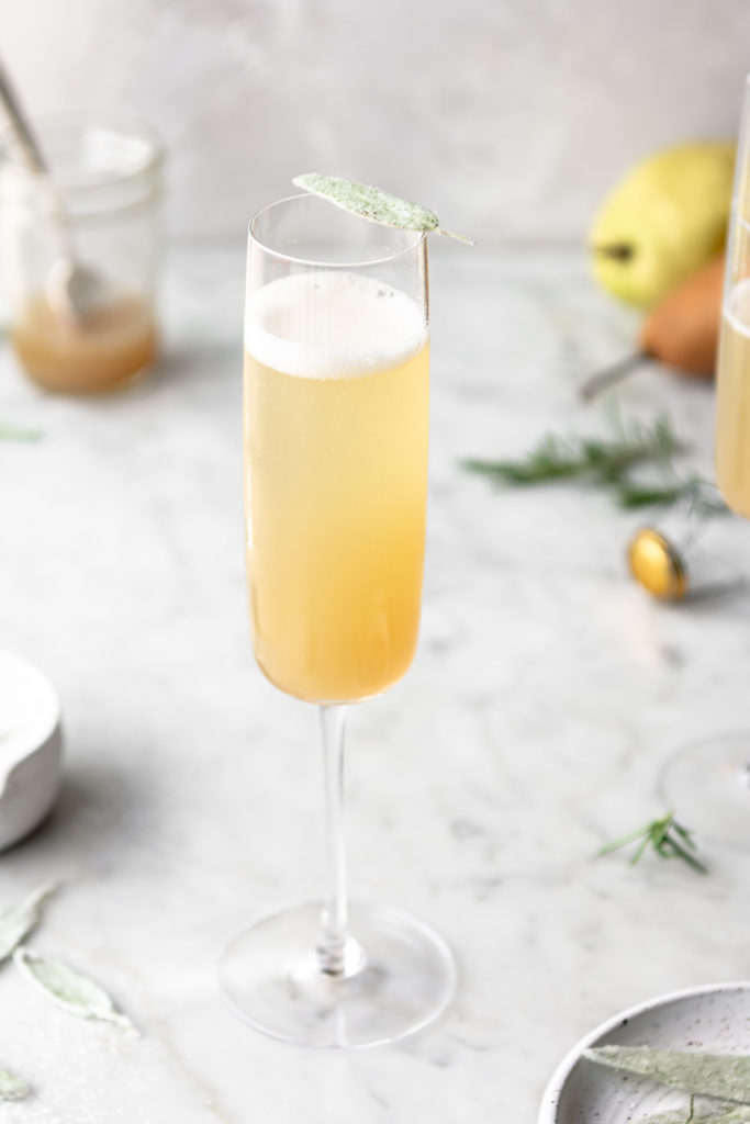 honey pear bellini with candied sage leaves