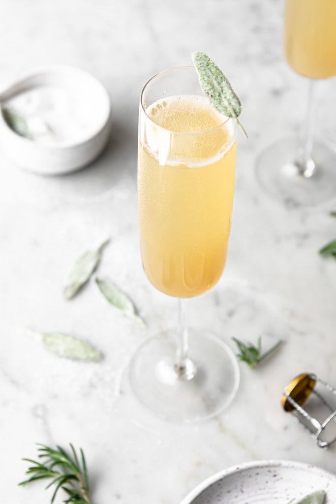 pear bellini with honey and crystallized sage leaves