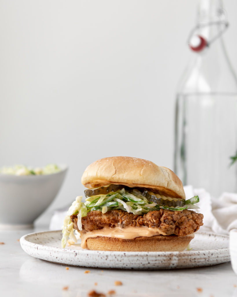 spicy fried chicken sandwich with sriracha mayo and jalapeno slaw
