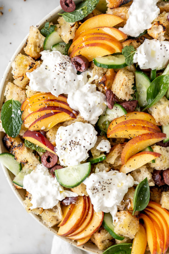 summer panzanella salad with burrata, cucumber, olives and peaches
