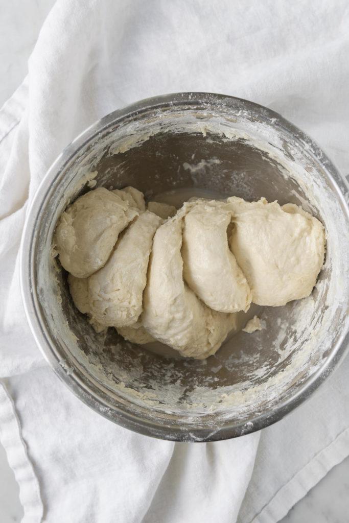 pinching through dough to mix yeast and salt