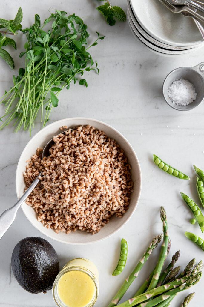 farro, asparagus, peas, pea shoots, avocado, dressing