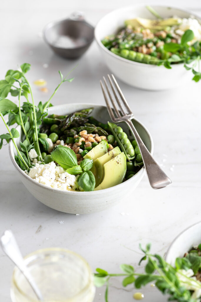 farro grain bowl with asparagus, avocado, peas and feta