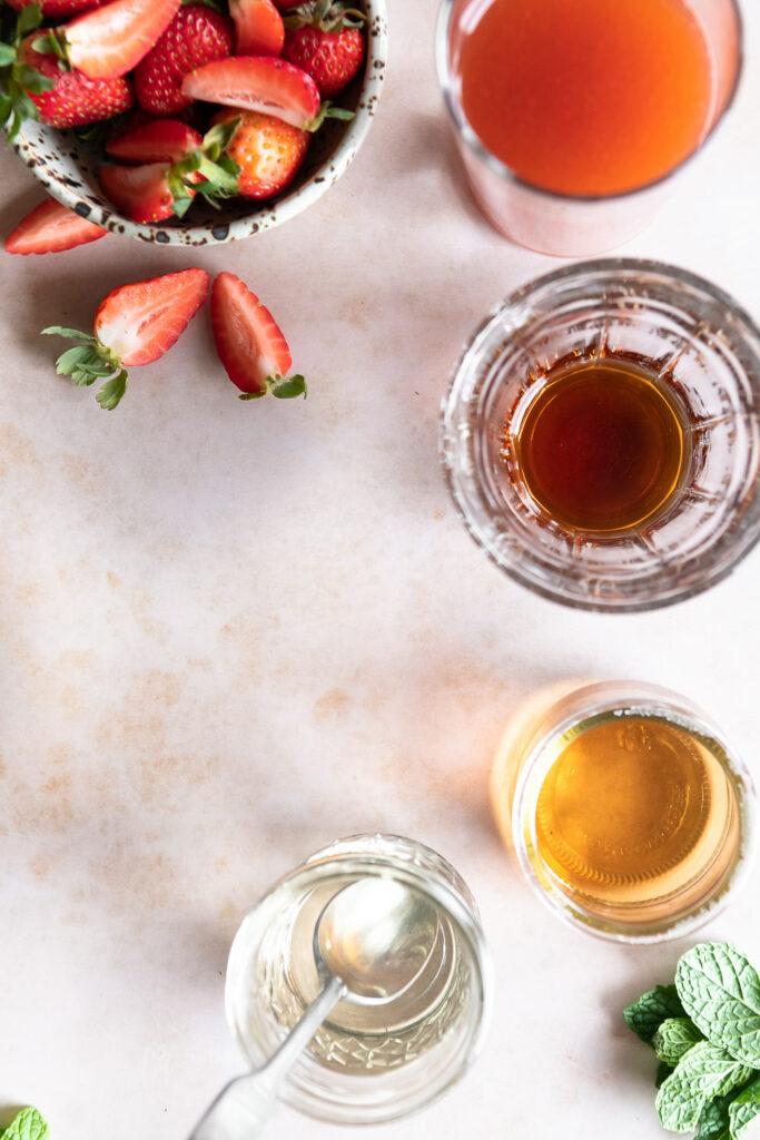 strawberries, rum, amaretto, simple syrup, fresh mint
