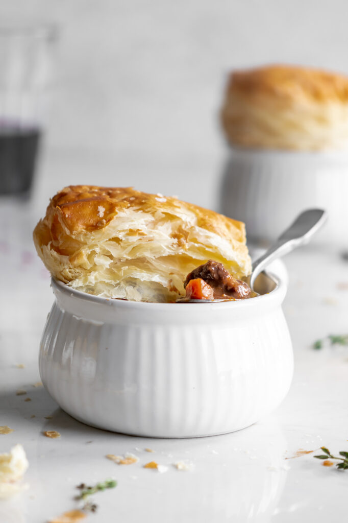 wine braised mushroom beef pie with puff pastry lids