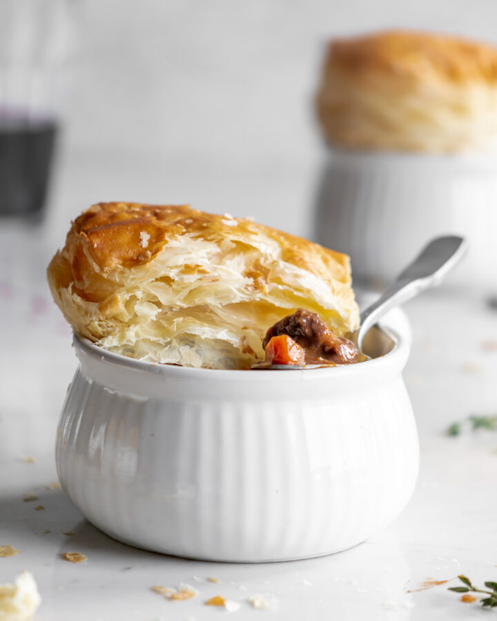wine braised mushroom beef pie with puff pastry lids
