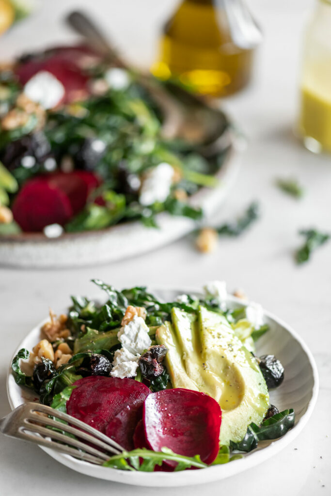 shaved beet salad with avocado, olives, goat cheese and citrus dressing