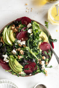 raw beet salad with avocado, olives, goat cheese and walnuts