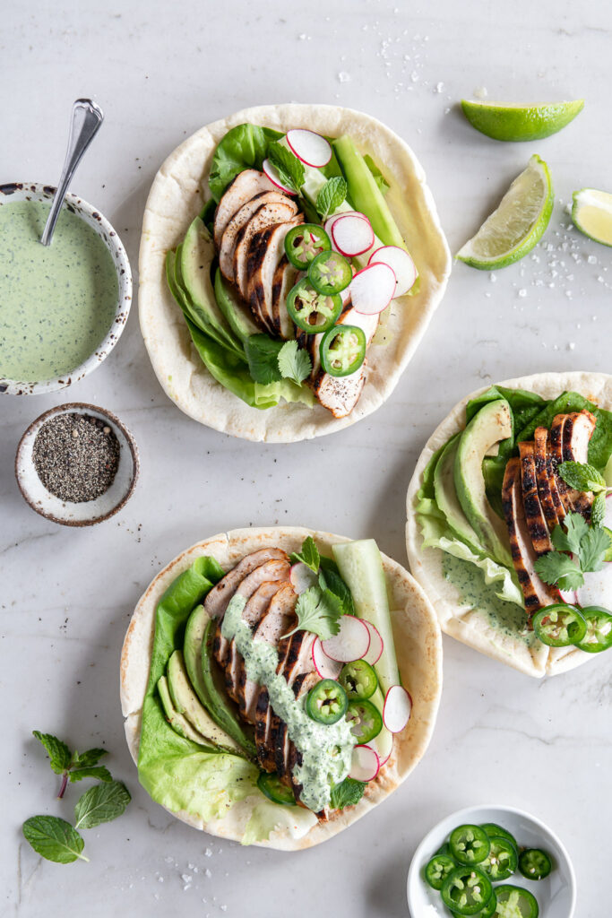 grilled chicken pitas with avocado, cucumber, radishes and lettuce