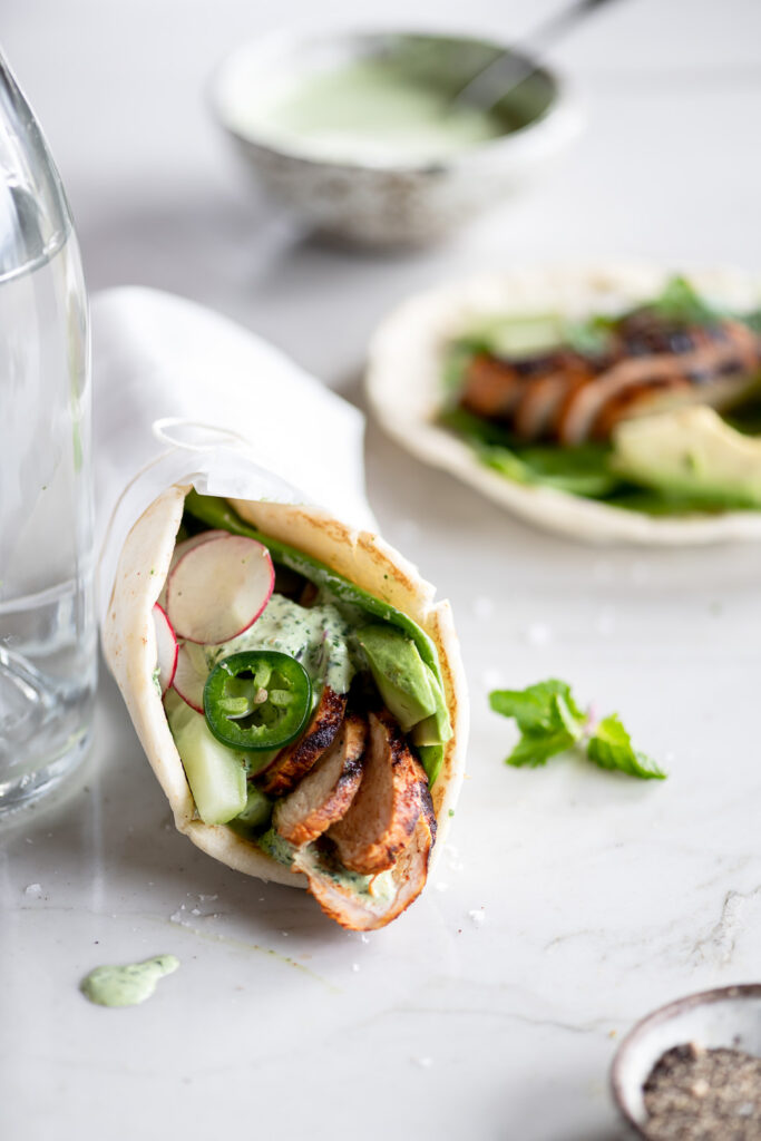 grilled chicken pitas with jalapenos, avocado, cucumber and radishes