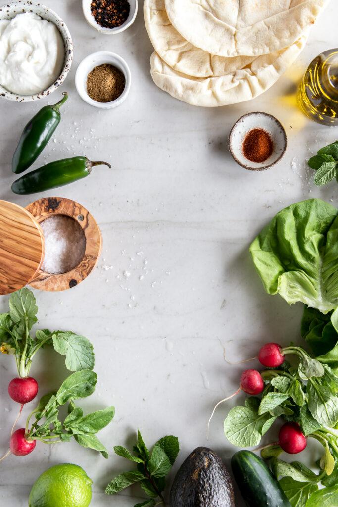 pita bread, jalapenos, yogurt, butter lettuce, avocado, radishes, cucumber
