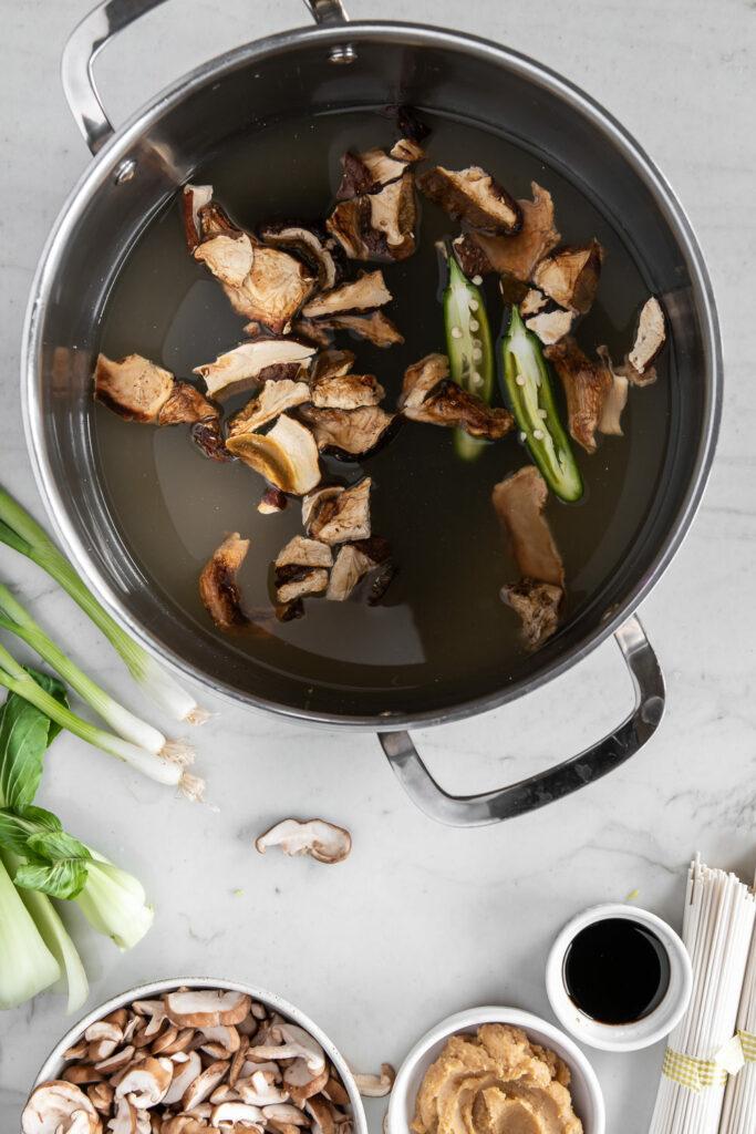 steeping mushrooms, kombu and peppers in broth