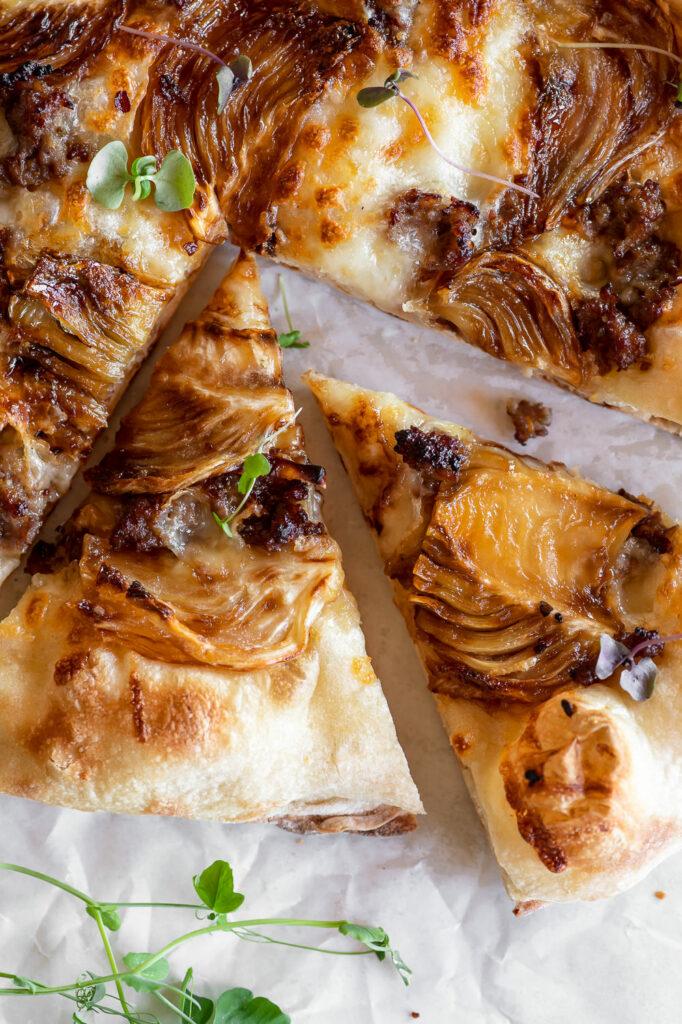 fennel pizza with spicy sausage, mozzarella and garlic oil