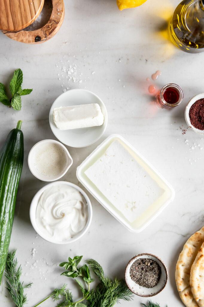 feta cheese, sour cream, cream cheese, olive oil, herbs, cucumber