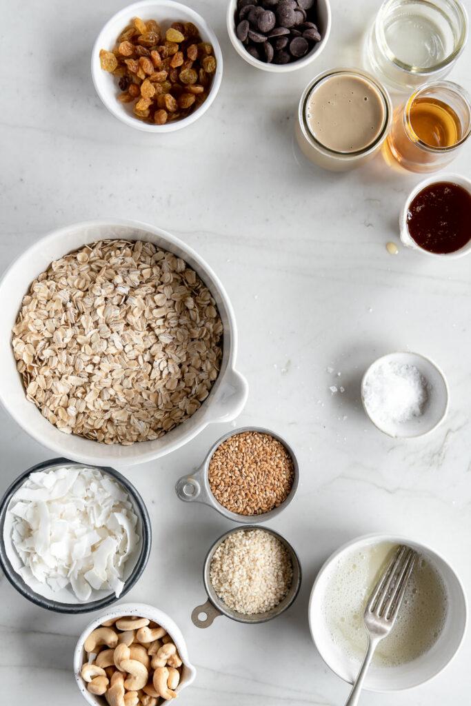 oats, tahini, coconut, sesame oil, sesame seeds, raisins, chocolate, flax seeds, egg white