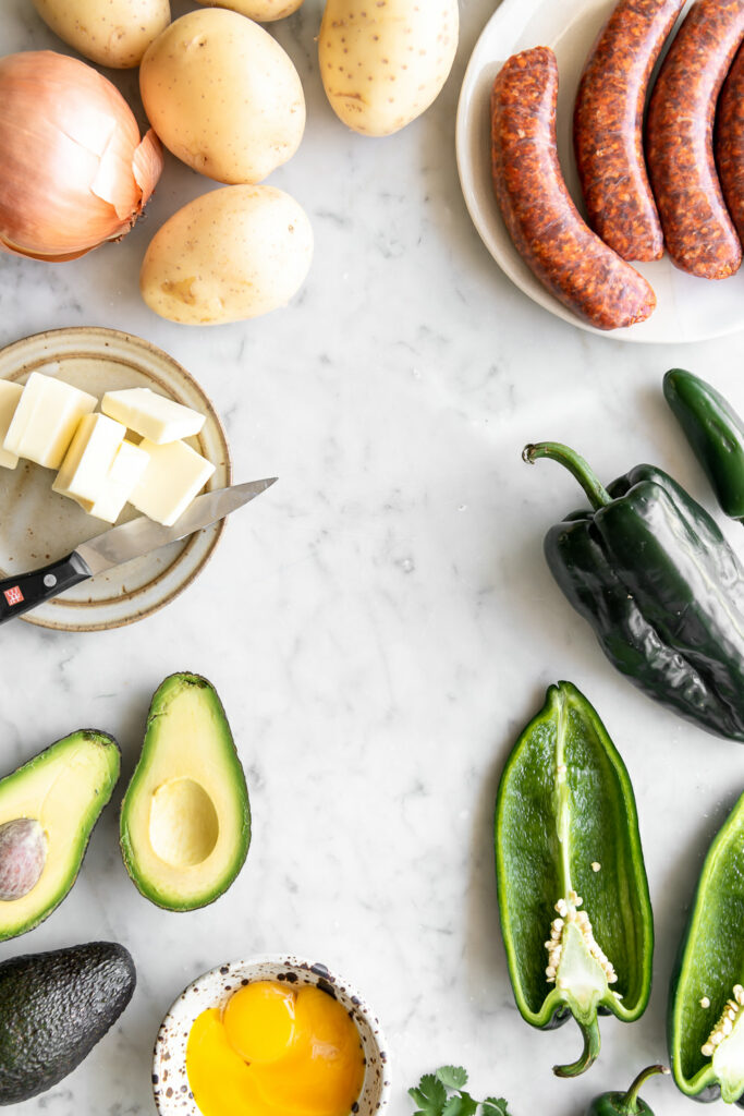 chorizo, potatoes, onions, poblano peppers, avocado, eggs