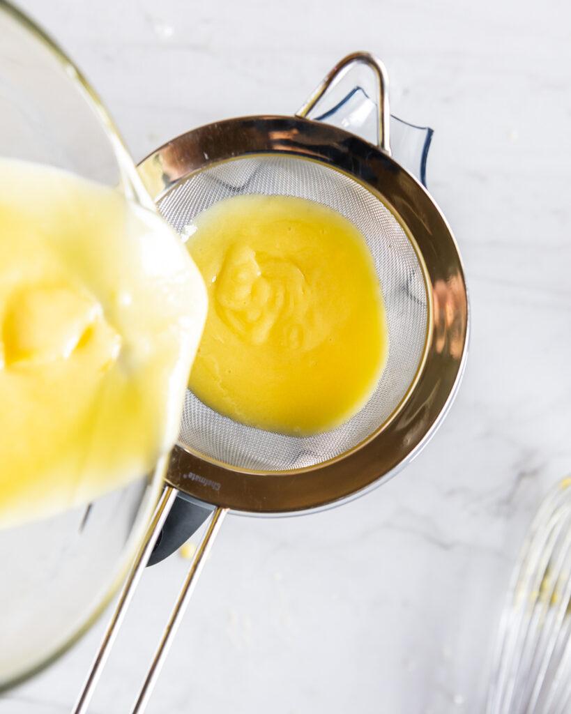straining lemon curd