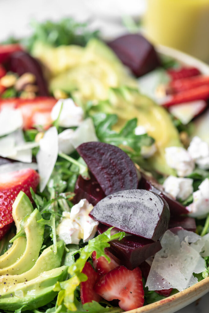beet goat cheese arugula salad with avocado and strawberries