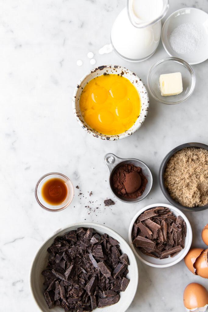 dark chocolate, egg yolks, cocoa powder, heavy cream, brown sugar, vanilla, butter, salt
