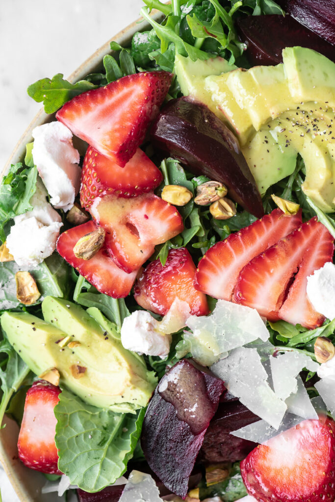 roasted beet salad with goat cheese and pistachios, avocado, strawberries and preserved lemon vinaigrette