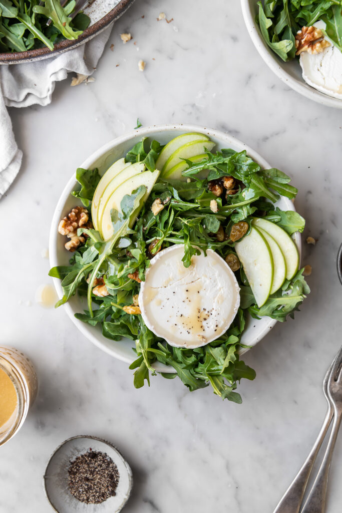 apple arugula salad with goat cheese, pickled raisins and walnut dressing