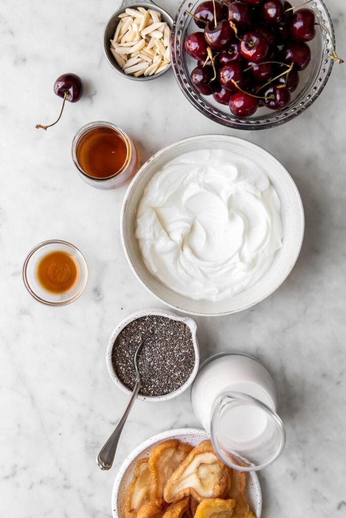 greek yogurt, chia seeds, almond milk, cherries, vanilla, salt, maple syrup, dried pears