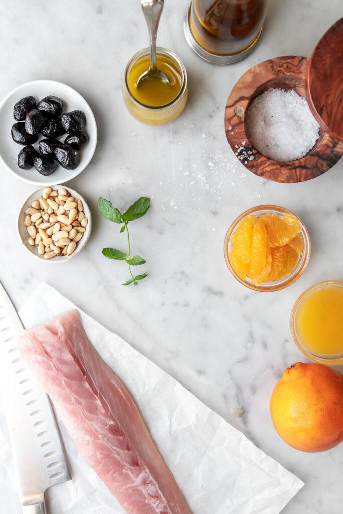 hamachi, pine nuts, orange, olives, olive oil, flaky salt