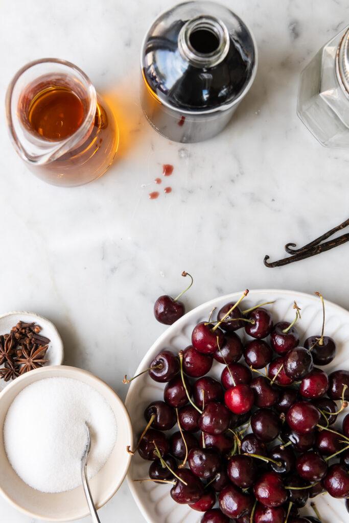 sweet red cherries, cherry juice, brandy, sugar, vanilla, spices